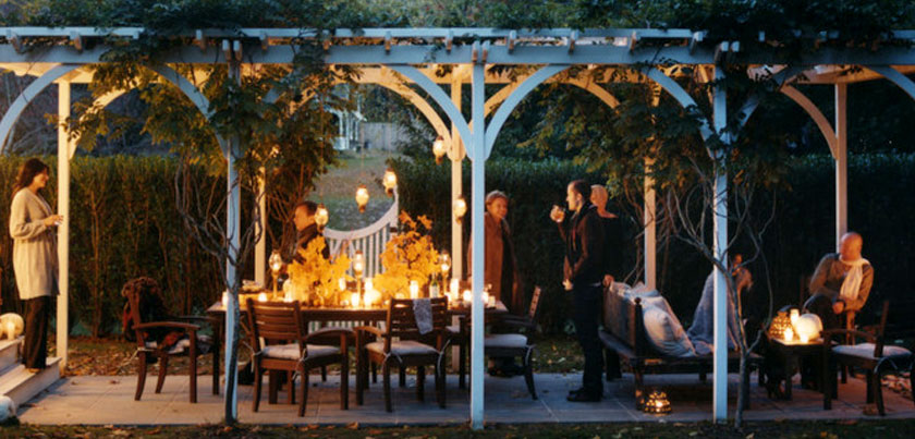 Fall Decorating: outdoor decorating, decorating ideas, porches, dining, dining tables, patio tables, table setting ideas, centerpieces, table centerpieces, fall centerpieces, autumn, fall, outdoors, tablescape, patio, shelter island, Long Island, New York, patio tablescape, evening, dining table, party, lanterns, leaves, gourds, pergola